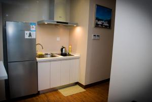 Chenlong Service Apartment - Yuanda building, Aparthotely  Šanghaj - big - 13