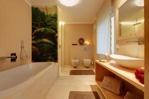 Crioli Dolomiti Lodge, Ferienwohnungen  Niederdorf - big - 9