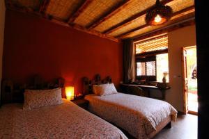 Banshan Huayu Inn, Guest houses  Lijiang - big - 2