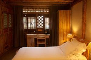 Banshan Huayu Inn, Guest houses  Lijiang - big - 60