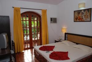 Sea Breeze Resort Candolim, Hotel  Candolim - big - 17