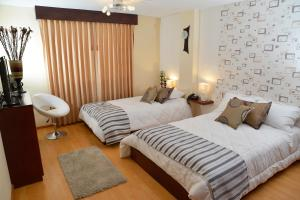 Ficoa Real Suites, Hotely  Ambato - big - 9