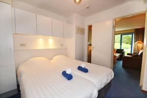 Appartement De Zeehond Amelander-Kaap, Апартаменты  Холлум - big - 19
