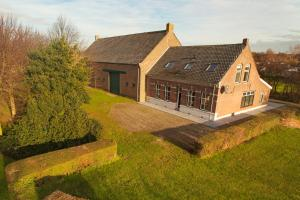 Vakantiewoning K&W, Holiday homes  Ouddorp - big - 1