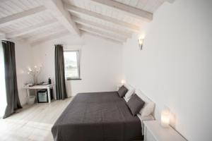 Dolce Dormire Suite, Penziony  Arcola - big - 2