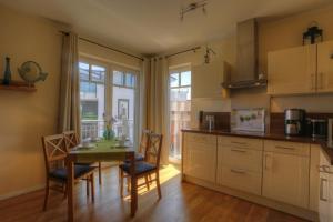 Ferienwohnungen Strandvilla Börgerende, Apartmány  Börgerende-Rethwisch - big - 44