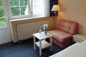 Dvoulůžkový pokoj s oddělenými postelemi v hostelu