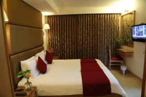 Hotel Western Gatz, Отели  Theni - big - 26