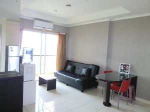 Dina Property at City Home MOI Apartment