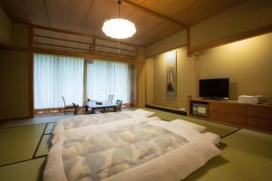 Фото отеля Osawa Onsen Sansuikaku