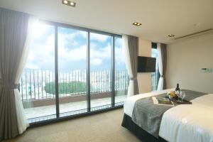 Benikea I-Jin Hotel, Hotel  Jeju - big - 27