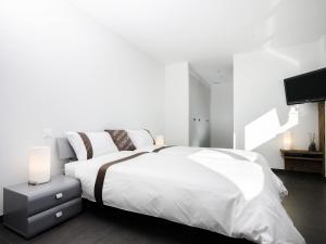BnB Le Haut des Vignes, Bed and Breakfasts  Lutry - big - 3