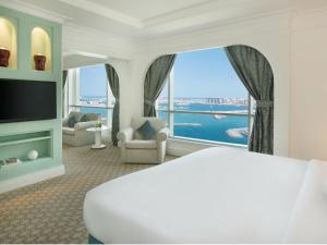 Suite Club con vistas parciales al mar