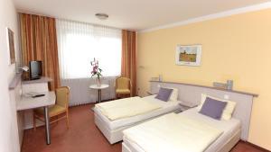 Doppel- oder Zweibettzimmer