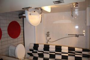 Appartement De Zeehond Amelander-Kaap, Апартаменты  Холлум - big - 5