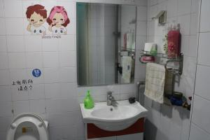 Baño Hippo Park Youth Hostel