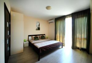 Sintria Court Apartments, Apartmanok  Balcsik - big - 38