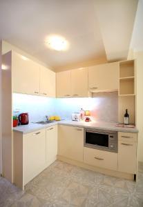 Sintria Court Apartments, Apartmanok  Balcsik - big - 3