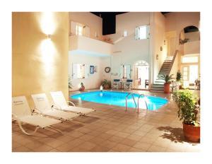 obrázek - Reverie Santorini Hotel