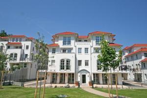 Haus Meeresblick - Ferienwohnung Dünenwind & Steuerbord