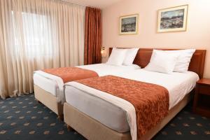 Hotel Glam, Отели  Скопье - big - 34