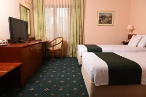 Hotel Glam, Отели  Скопье - big - 19