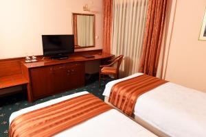 Hotel Glam, Отели  Скопье - big - 17