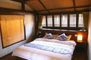 Lijiang Shuhe Qingtao Inn, Penziony  Lijiang - big - 9