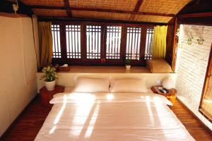 Lijiang Shuhe Qingtao Inn, Affittacamere  Lijiang - big - 12