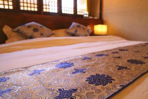 Lijiang Shuhe Qingtao Inn, Affittacamere  Lijiang - big - 18