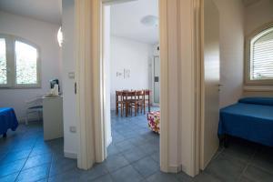 Le Bianche, Apartmanok  Torre Suda - big - 8