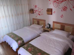 Xinyueju Inn, Pensionen  Lijiang - big - 8