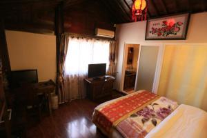 Lijiang Jinsheng Youyue Inn, Affittacamere  Lijiang - big - 58