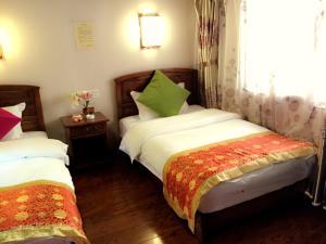 Lijiang Jinsheng Youyue Inn, Affittacamere  Lijiang - big - 56