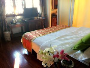 Lijiang Jinsheng Youyue Inn, Affittacamere  Lijiang - big - 11