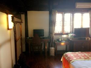 Lijiang Jinsheng Youyue Inn, Affittacamere  Lijiang - big - 31