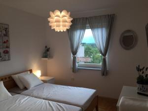 Apartments Papalinna, Апартаменты  Малинска - big - 18