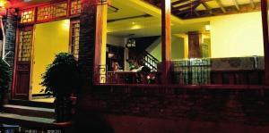 Fenghuang Yiguangnian Fashion Hotel