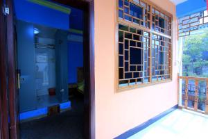 Фото отеля Qianbaidu Inn