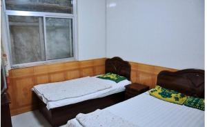 Beidaihe Xiuqin Linhai Homestay, Privatzimmer  Qinhuangdao - big - 5