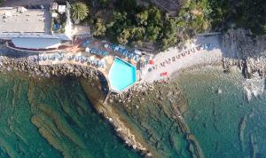 Prenota Hotel Le Rocce Del Capo