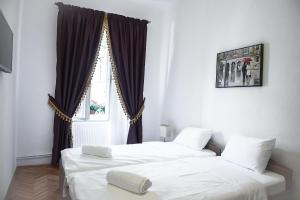 Apartament Piata Mica, Apartmanok  Nagyszeben - big - 21