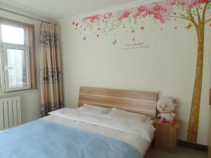 Qingdao Xinjie Li Holiday Apartment