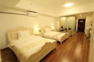 Foshan Keruisi Apartment (Nanhai Wanda SOHO Branch), Apartmány  Foshan - big - 14