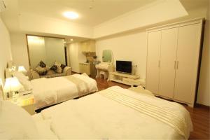 Foshan Keruisi Apartment (Nanhai Wanda SOHO Branch), Apartmány  Foshan - big - 13