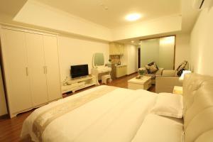 Foshan Keruisi Apartment (Nanhai Wanda SOHO Branch), Apartmány  Foshan - big - 11