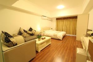 Foshan Keruisi Apartment (Nanhai Wanda SOHO Branch), Apartmány  Foshan - big - 10