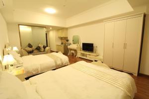 Foshan Keruisi Apartment (Nanhai Wanda SOHO Branch), Apartmány  Foshan - big - 6