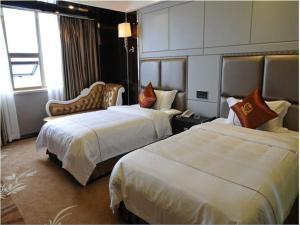 Фото отеля Fuhao Jinzuo Hotel