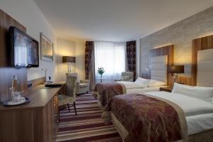 Dvoulůžkový pokoj typu Premium s manželskou postelí